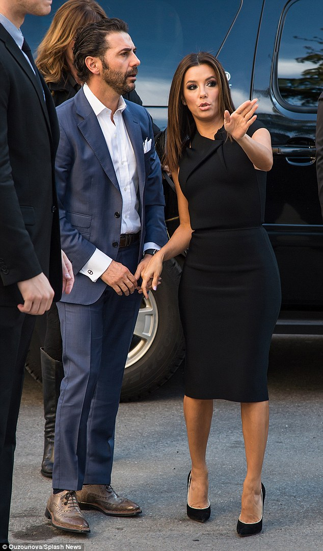 Best accessory: Eva's beau Antonio, aged 45, arrived by the star's side wearing a blue blazer with matching trousers, a white button-down shirt and brown-grey Oxfords