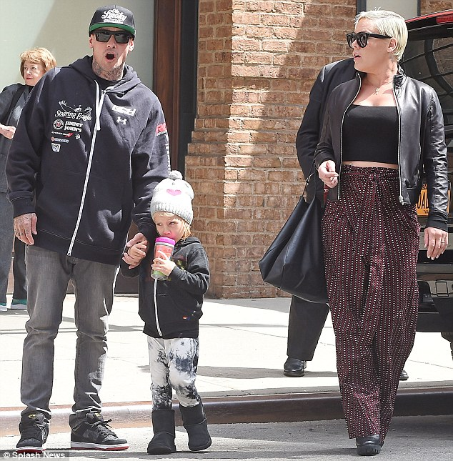 What a match! Willow matched her dad's style in a black hoodie, white trousers, thermal boots and a grey beanie that featured a heart graphic emblazoned across the front