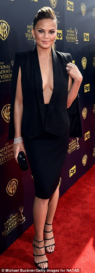 All-black ensemble: Posing outside Warner Bros. Studios, the Lip Sync Battle co-host accessorised with a black clutch, sparkly bracelet, and onyx earrings