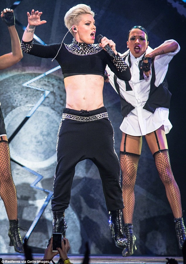 Ripped! Pink showcased her washboard abs while performing in Paris in 2013