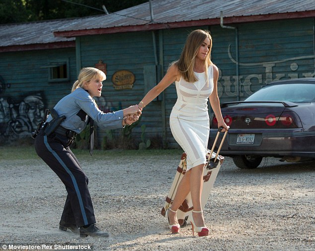 Contrast: Reese is seen in a frumpy cop uniform while Sofia dons a tight dress in much of the film
