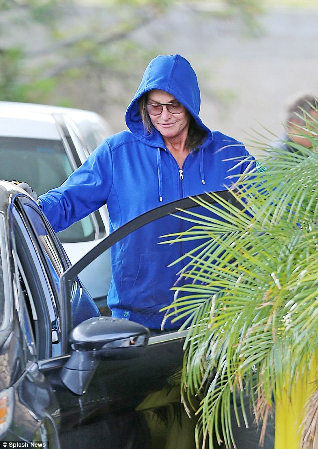 Beaming: Bruce kept his hood up to conceal his identity as he gassed-up... but there was no hiding that smile
