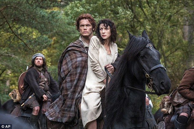 Smouldering: Sam Heughan, 34, has been winning over viewers with his performance in Outlander