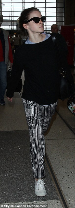 Laid-back: Emma looked comfy and casual for her flight in her black and white look
