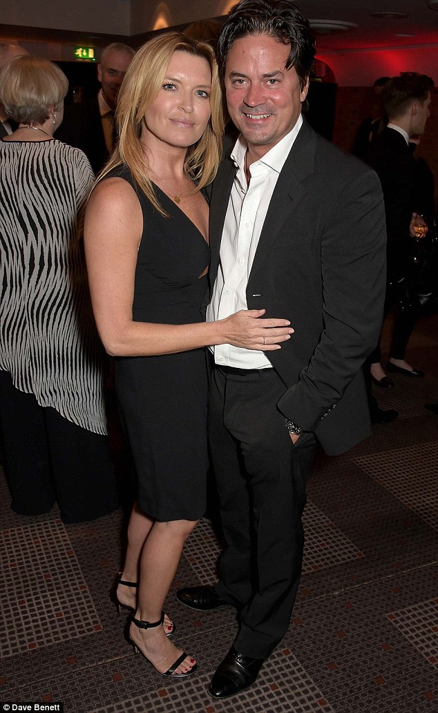 Close couple: Tina Hobley and Oliver Wheeler make a handsome couple as they cuddle up inside