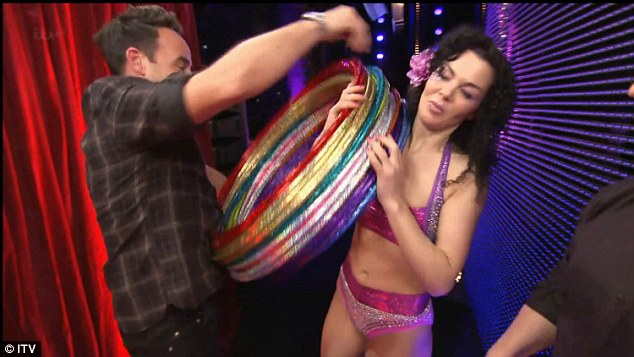 The grand finale: As her act neared its end, she grabbed a large stack of multi-coloured hoops