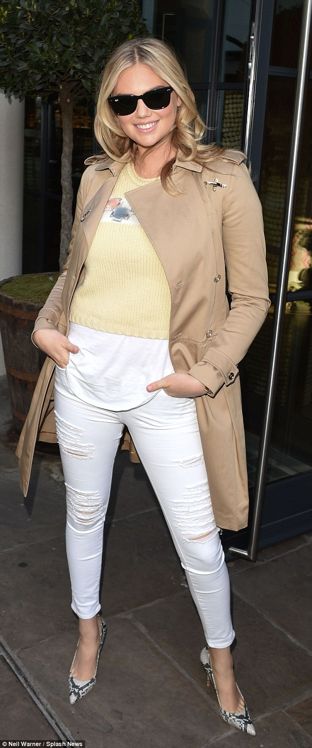 Strike a pose: Kate Upton arrives at the Radio 1 studios in London on Monday morning for an appearance on Nick Grimshaw's Breakfast Show