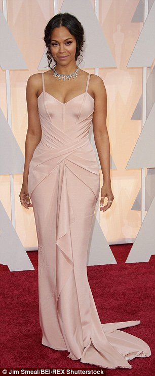 Different look: More familiar for her glamorous appearance (like at the Oscars in February, right), Zoe remained beautiful while going casual