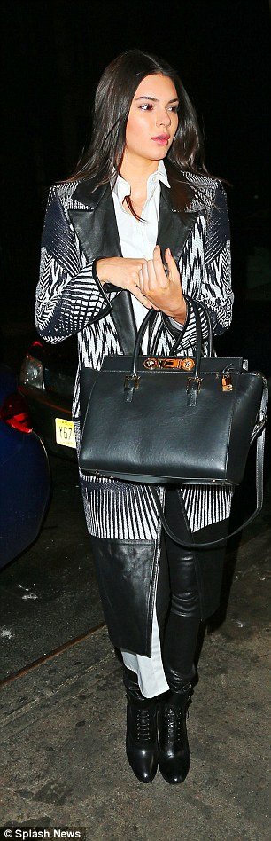 Fashionista:Kendall complemented the pants with an over-sized white button-down top, a black and white graphic-print blazer, black boots and a black leather satchel