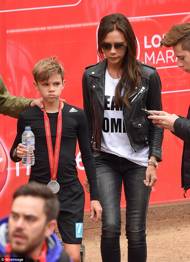 Me and mum: Victoria stuck close to Romeo after he caught his breath after the race