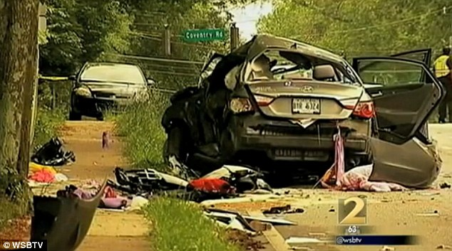 Aftermath: The wreckage of the teacher's Hyundai Sonata car which was hit by the student's Dodge Charger