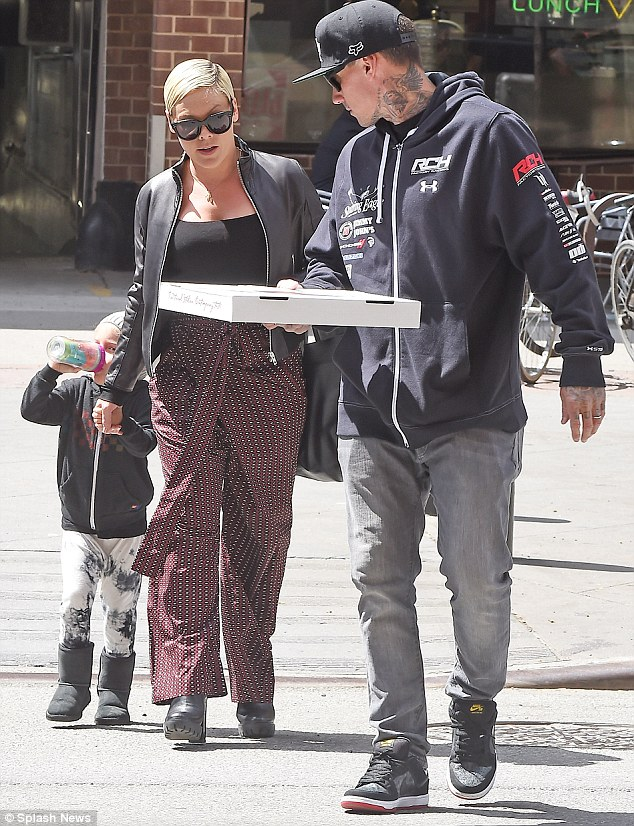 Family affair: The family-of-three exited the pizza shop with Carey holding the pie and Pink taking her mini-me by the hand as they went back to their hotel in the Big Apple's Tribeca neighborhood ahead of checking out