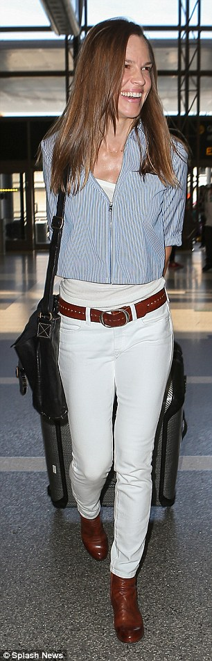 Smooth ride: Considering her white clothing, Hilary was either very brave or very confident of no in-flight turbulence