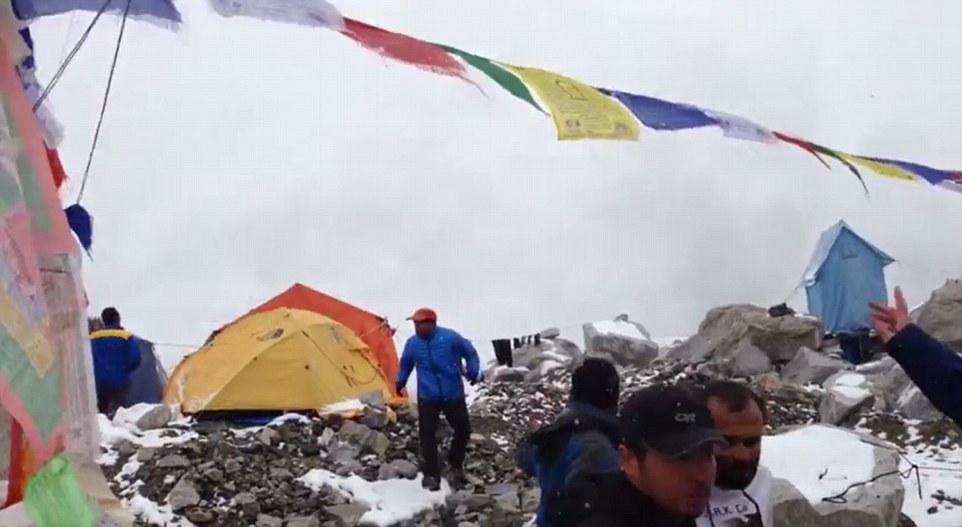 Amateur video footage shows a huge wall of snow and debris hurtling towards Everest Base Camp as climbers run for cover