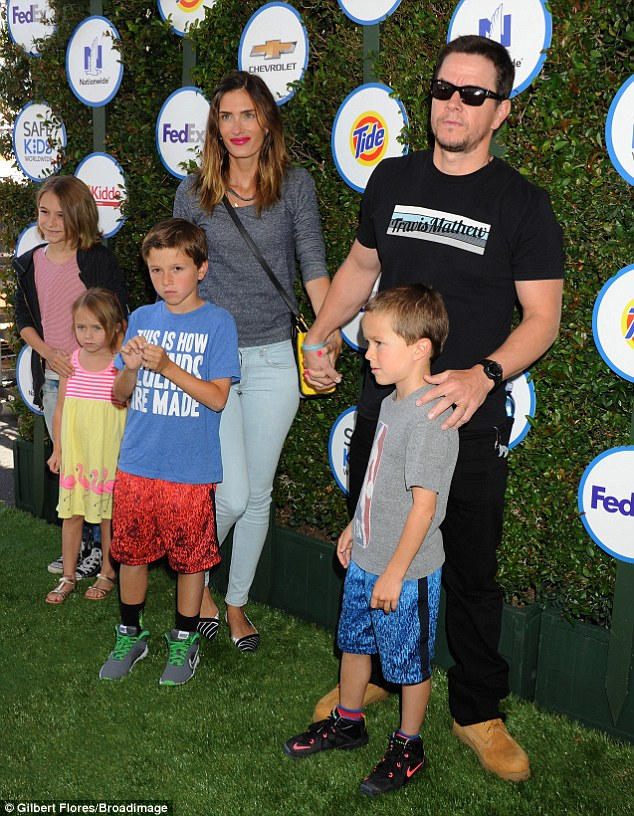 Famous Dad perks: Mark Wahlberg accompanied his wife Rhea Durham, 36, and their four children Ella, aged 12, Michael, aged eight, Brendan, aged six, and Grace, aged four to the 2015 Kids Safe Day in Los Angeles on Sunday