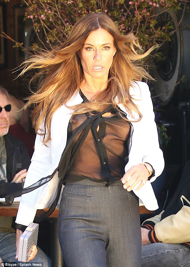 Runway ready: Kelly's golden tresses blew dramatically in the wind as she walked, making for a stunning shot of the star