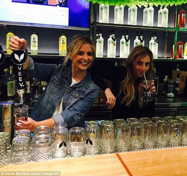 Raising her spirits! The mother-of-two assumed the role of bartender for a meeting on Friday