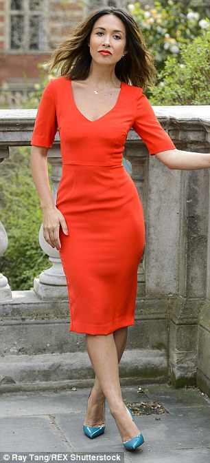 Spring is in the air: Myleene showed off her legs as she posed outside the iconic London building