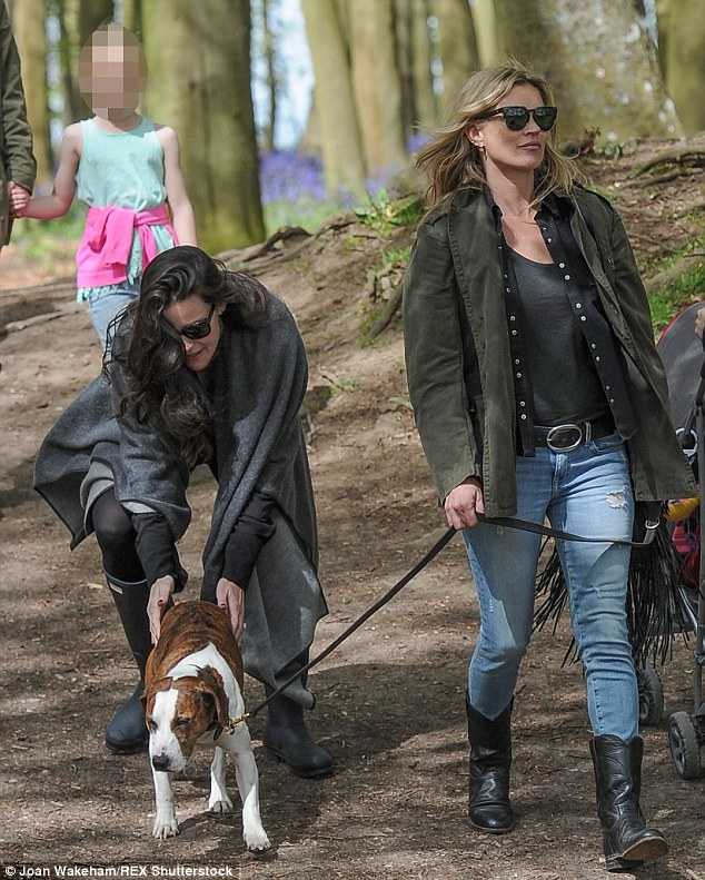 Animal lover: Liv cooed over Archie who appearedd to be a little non-plussed