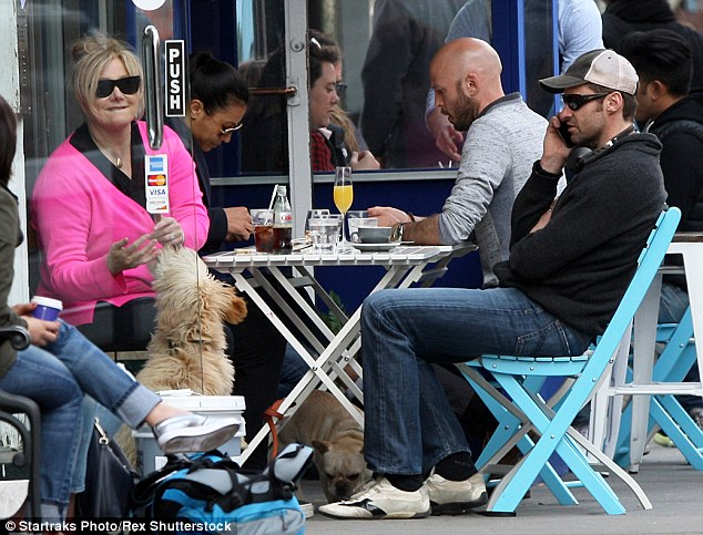 For two please: While Deb enjoyed chatting to on-lookers, Hugh was glued to his phone