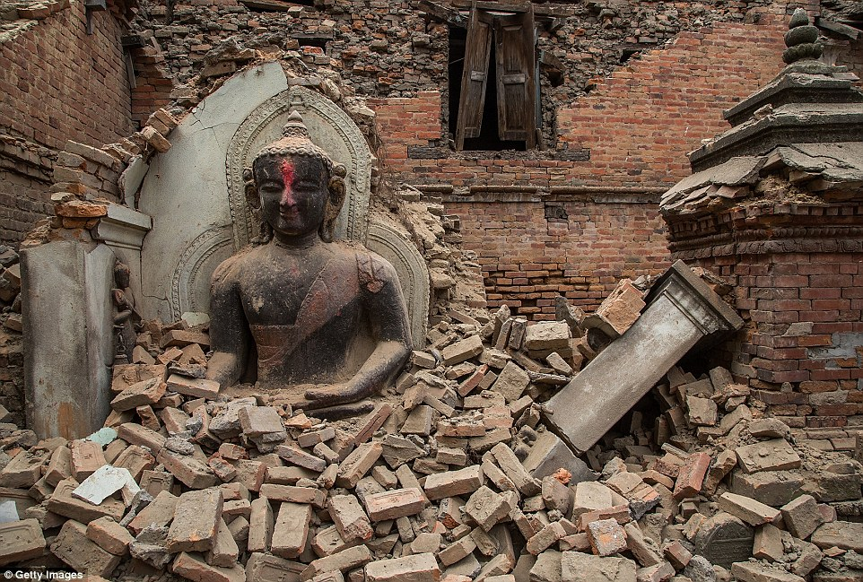 In Bhaktapur, a Buddha survived when the rest of the temple collapsed. Many of the country's temples - which attract thousands in tourism every year - were destroyed
