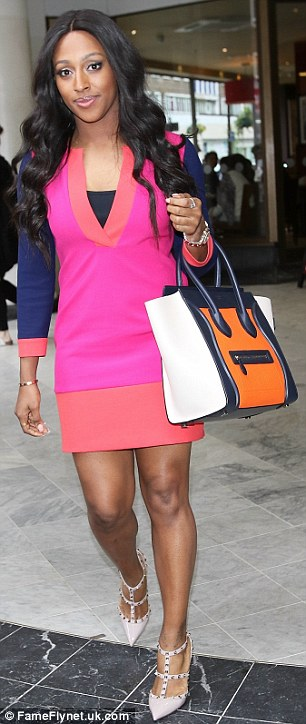 Rocking it: Alexandra showed off her enviable physique in a colour block dress with nude heels