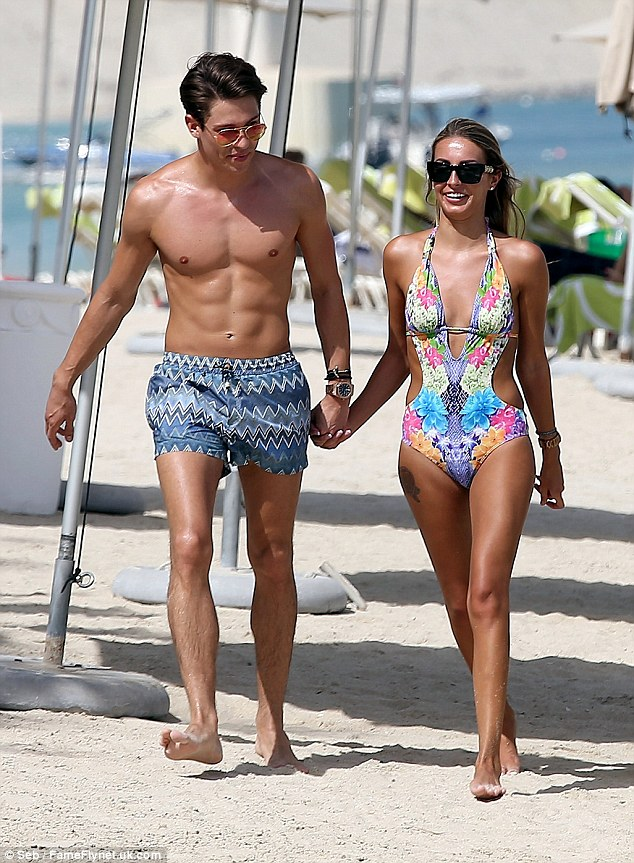 Scorching: The hot new couple looked sensational in their swimwear, with a perfect tan to match