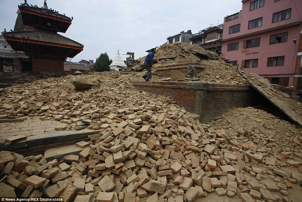 A man walks through the ruins of one of the city's famous temples at Durbar Square in Patan as the city reels from the devastating earthquake