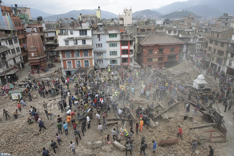 People search for survivors under the rubble of collapsed buildings in Kathmandu Durbar Square, a UNESCO sitem after an earthquake caused serious damage