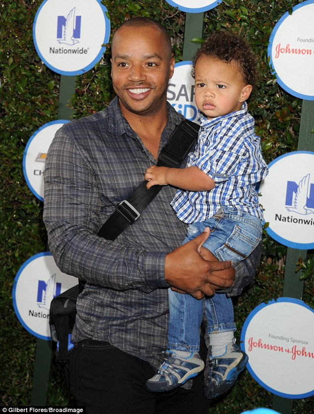 Daddy duties: Donald Faison left two-day-old newborn baby girl Wilder Frances - whose godmother is Jessica Simpson - at home with wife CaCee Cobb as he attended the bash with eldest child Rocco, aged one