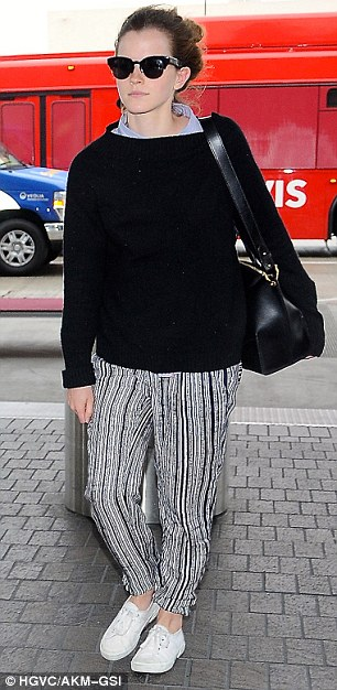 Natural beauty:The UN Women Goodwill Ambassador looked fresh faced, and make-up free as she headed into the airport