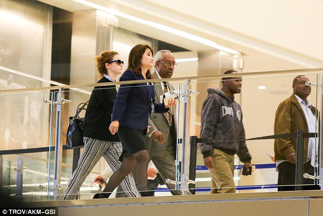 Airport dash: The star was led through departures by staff as she hurried to make her flight