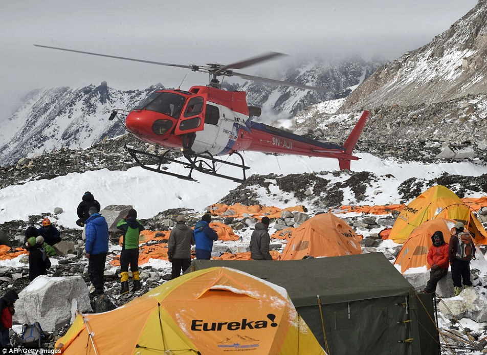 Retrieval: A rescue helicopter prepares to land and airlift the injured from Everest Base Camp on Sunday. Survivors feared that many of those hurt would not make it