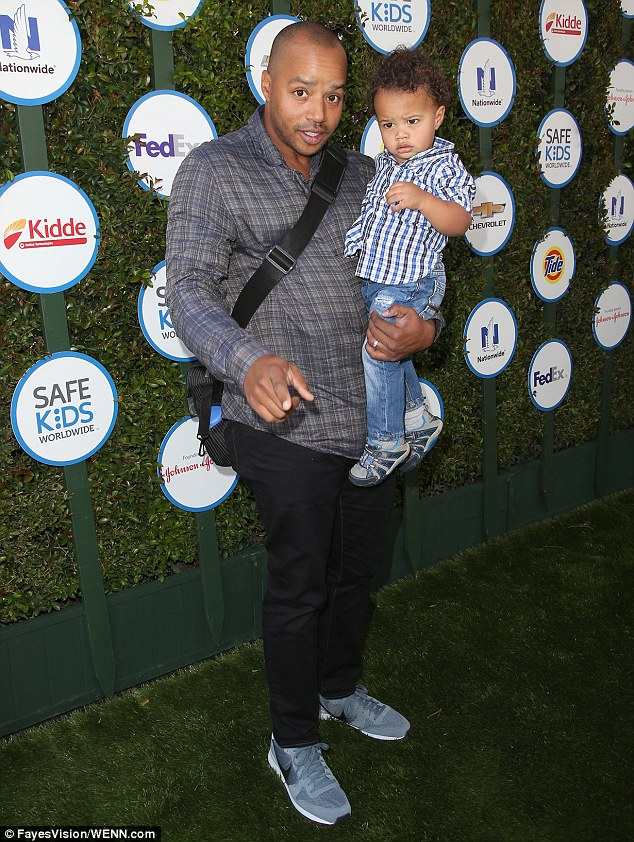 New dad: Donald Faison brought his son, one-year-old Rocco, to enjoy the festivities, two days after his wife CaCee Cobb gave birth to their new daughter, Wilder Frances