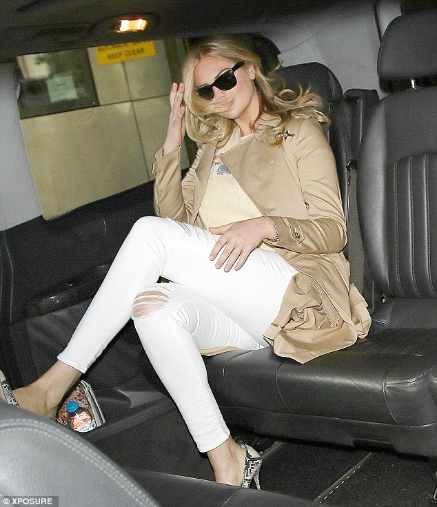 Leggy: The blonde's stunning figure was in display in her tight white skinnies and heels