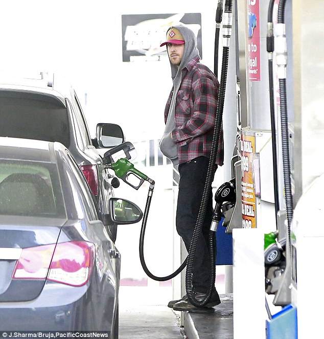 Going incognito: Ryan Gosling went low-key as he stopped to fill up his tank in Los Angeles on Saturday