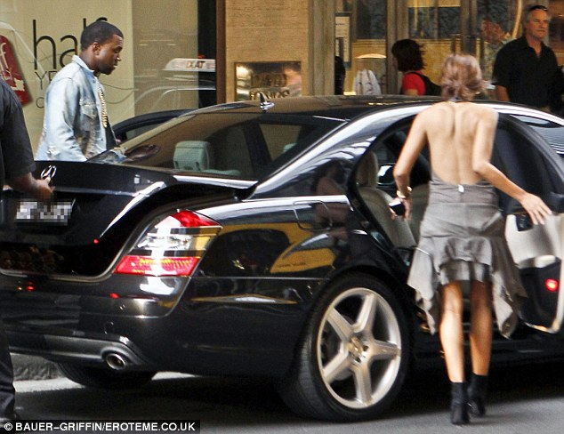 Shopping trip together: Kanye and Christine were spotted shopping together in Sydney in January 2012