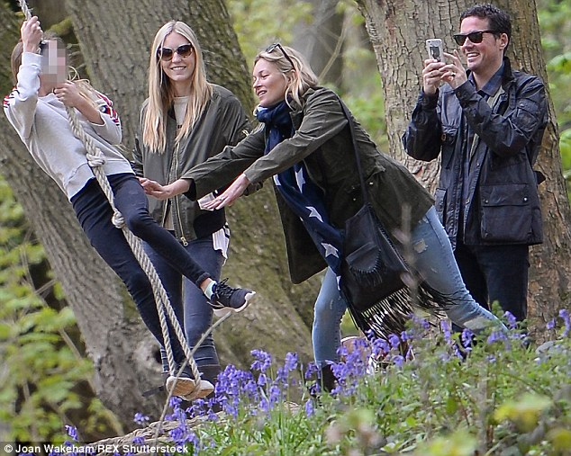 Say cheese! Kate had a big smile on her face as she had fun with her 12-year-old as Dave snapped pictures on his phone