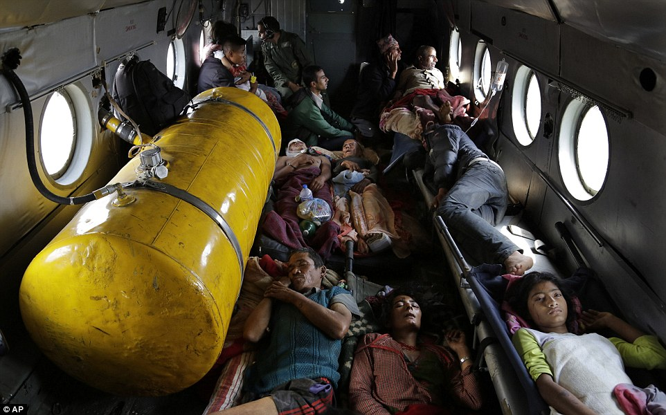 Nepalese victims lie inside an Indian air force helicopter as they are evacuated from Trishuli Bazar to Kathmandu airport in Nepal