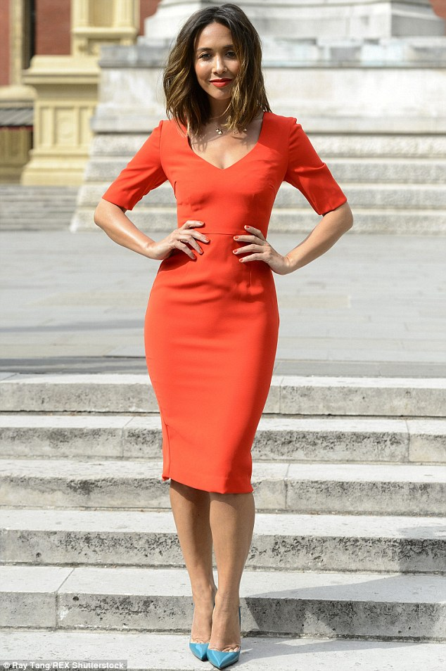 Lean and slender:Her slender curves were perfectly accentuated thanks to the knee-length frock, which boasted a V-neck detail and an exposed full back zip