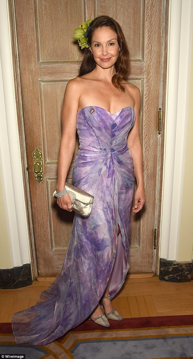 Lovely in lilac: Ashley Judd wowed in a patterned strapless dress, adding a flower in her hair