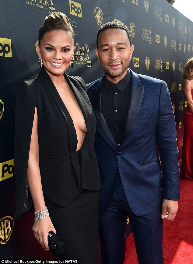 An eyeful of cleavage: Chrissy took the plunge in a caped blazer and pencil skirt as the pair rocked the red carpet together