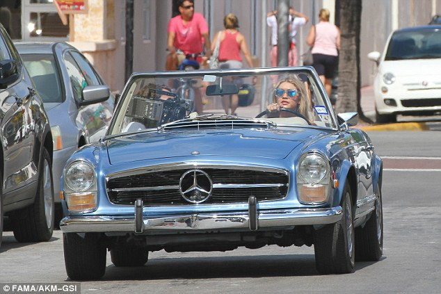 Hot wheels! She was photographed while driving a vintage Mercedes Benz convertible in Miami on Saturday