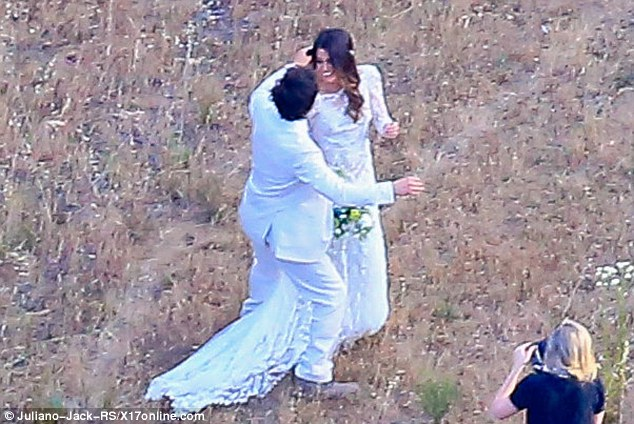 Happiest day of her life: Nikki could barely keep the smile from her face as her man carefully tucked a piece of hair from her face