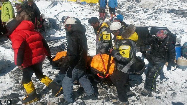 A critically injured person is carried on a stretcher out of Everest Base Camp following the avalanche. Dr Gallant said despite trying everything she watched a 25-year-old Sherpa die from his injuries on the mountain