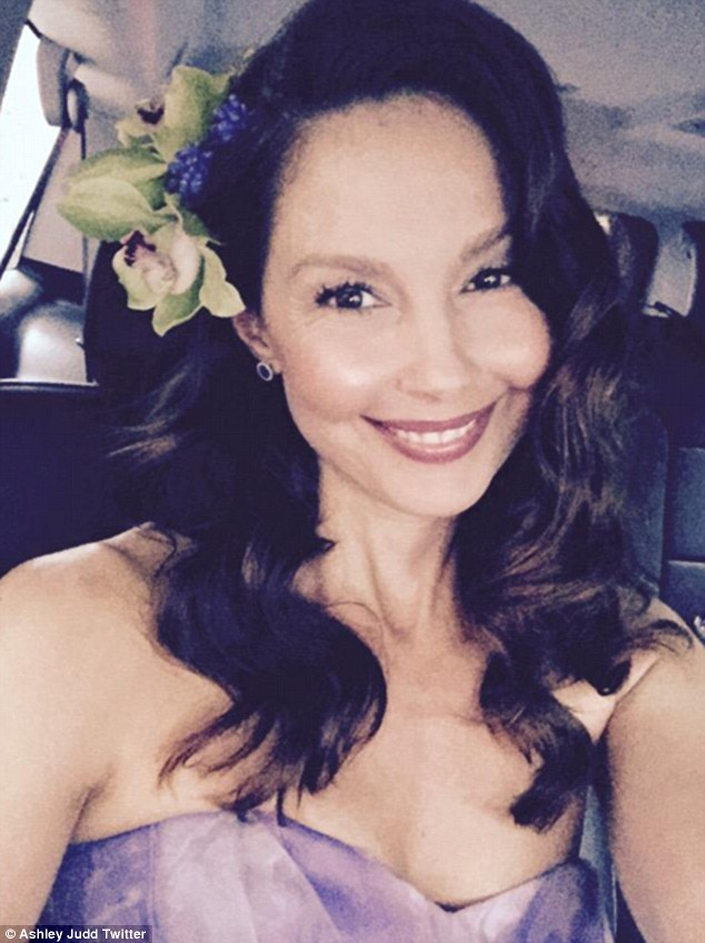 On her way: The brunette beauty took to Twitter to share her look on the way to the dinner, writing:'Thank you @katiecouric & @Yahoo for hosting me for the #WHCD2015'
