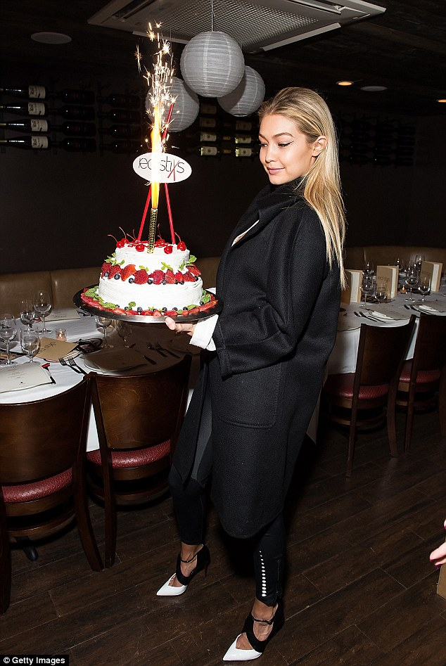 Let them eat cake: She posed with a decadent, fruit-covered cake as she celebrated her big day