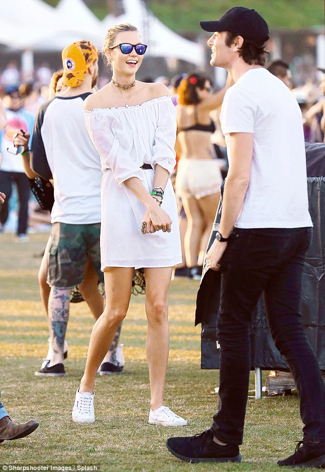 Festival vibes: The 22-year-old model dressed her lean and slender frame in a bohemian-inspired little white number, which boasted an off-the-shoulder detail and ruching along the bodice