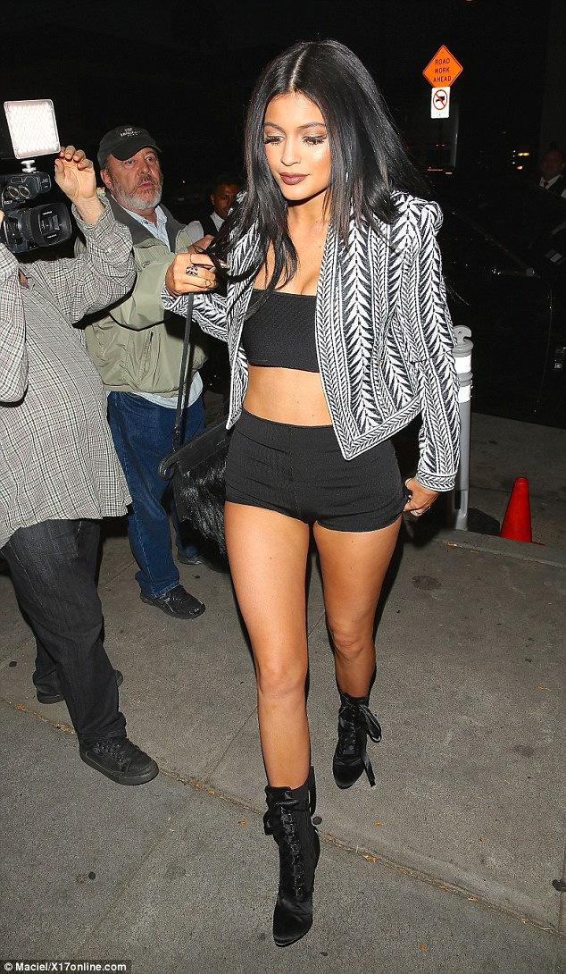 Romantic feud: Kylie, seen here out for dinner with her family in LA on Thursday, indirectly suggested  claims made by Blac Chyna that Tyga was sending her text messages about a reconciliation were fake