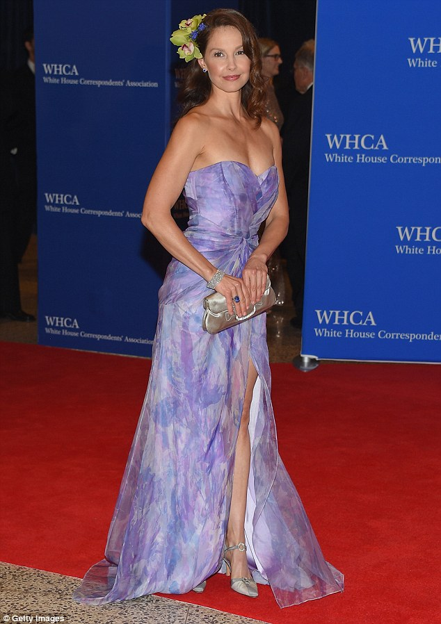 Pretty in purple: Ashley showed off her stunning figure in a colorful strapless dress which featured a large slit up the front